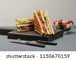 classic club sandwich with ham... | Shutterstock . vector #1150670159