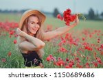 beautiful woman with long blond ... | Shutterstock . vector #1150689686