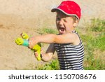 child with a water pistol. the...   Shutterstock . vector #1150708676