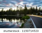 passing car at mosquito lakes... | Shutterstock . vector #1150714523