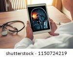 doctor holding a digital tablet ...   Shutterstock . vector #1150724219