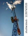 construction crane partially... | Shutterstock . vector #1150765520