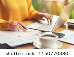 young accountant woman checking ... | Shutterstock . vector #1150770380