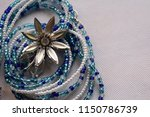 blue and white beads wrapped in ... | Shutterstock . vector #1150786739