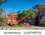 a beachside toilet block with... | Shutterstock . vector #1150789370