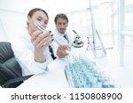 biological laboratory worker in ... | Shutterstock . vector #1150808900