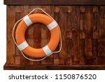 orange lifebuoy ring hanging on ... | Shutterstock . vector #1150876520
