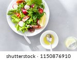 top view plate fresh salad with ... | Shutterstock . vector #1150876910