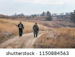 two hunters moving with shotgun ... | Shutterstock . vector #1150884563