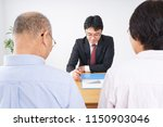 aged couple and salesperson... | Shutterstock . vector #1150903046