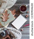 autumn background on a wooden... | Shutterstock . vector #1150904630