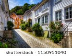 beautiful cobbled street in the ... | Shutterstock . vector #1150951040