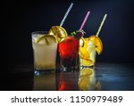 fresh cocktail on a black... | Shutterstock . vector #1150979489