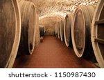 cellar with barrels of wine | Shutterstock . vector #1150987430