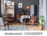 orange lamp above dining table...   Shutterstock . vector #1151022059
