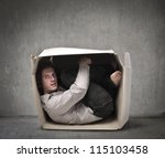 man crouched in a box | Shutterstock . vector #115103458
