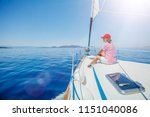 young woman relaxing on yacht... | Shutterstock . vector #1151040086