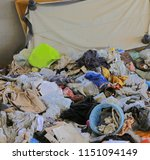 Small photo of rags and garbage in an illegal shelter for illegal immigrants discovered by the police