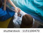 asian woman doctor... | Shutterstock . vector #1151100470