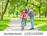 mom teaches her daughter to... | Shutterstock . vector #1151132390