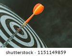 red dart arrow hitting in the... | Shutterstock . vector #1151149859