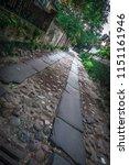 rainbow row street in... | Shutterstock . vector #1151161946