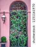 rainbow row street in... | Shutterstock . vector #1151161970