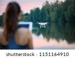 young beautiful woman controls... | Shutterstock . vector #1151164910
