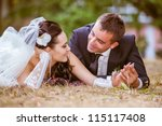 wedding shot of bride and groom ... | Shutterstock . vector #115117408