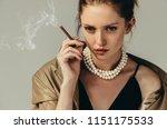 femme fatale. portait of a... | Shutterstock . vector #1151175533