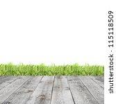 green grass with wooden pier | Shutterstock . vector #115118509