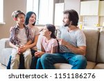 happy family sits together on... | Shutterstock . vector #1151186276