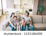 beautiful family is sitting on... | Shutterstock . vector #1151186300