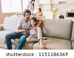 man is sitting on sofa with his ... | Shutterstock . vector #1151186369