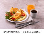 herb omelette with chives ... | Shutterstock . vector #1151193053