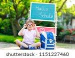 happy little kid boy with... | Shutterstock . vector #1151227460