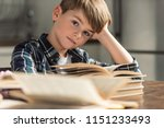 bored little schoolboy with... | Shutterstock . vector #1151233493