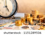 table clock and gold coin stack ... | Shutterstock . vector #1151289536