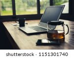 laptop on wooden desk with... | Shutterstock . vector #1151301740