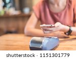 woman paying with nfc... | Shutterstock . vector #1151301779