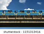 metro train on overpass in move | Shutterstock . vector #1151313416