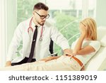 male doctor is talking and... | Shutterstock . vector #1151389019