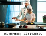 the chef and assistant add the... | Shutterstock . vector #1151438630