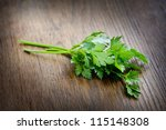 green parsley lying on a dark... | Shutterstock . vector #115148308