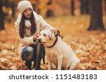 Stock photo headphones on labrador young woman with dog autumn park walking with pets outdoor pets and 1151483183