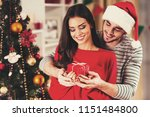 handsome boyfriend give present.... | Shutterstock . vector #1151484800