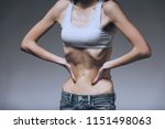 woman hold hands in belly ribs. ... | Shutterstock . vector #1151498063