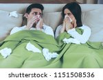 sick couple blowing noses.... | Shutterstock . vector #1151508536