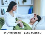 sad girl touche forehead.... | Shutterstock . vector #1151508560