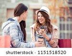 pretty girsl sitting in street... | Shutterstock . vector #1151518520